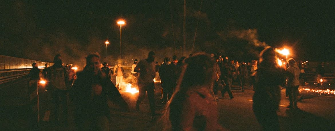 people at a protest at night